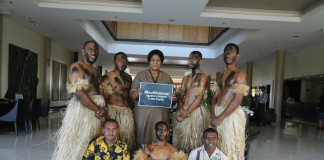 A participant at the Ending Violence Against Children Conference shows her support with members of the Fiji Police Blue Light youth group, Island Life copy